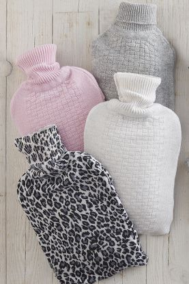 Pure cashmere hot water bottle covers shown in baby pink, grey and cream