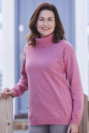 Women's 4 Ply cashmere cable roll collar in pink.