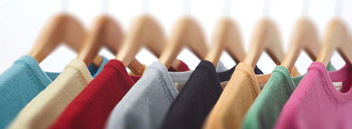 Selection of cashmere Sweaters on hangers